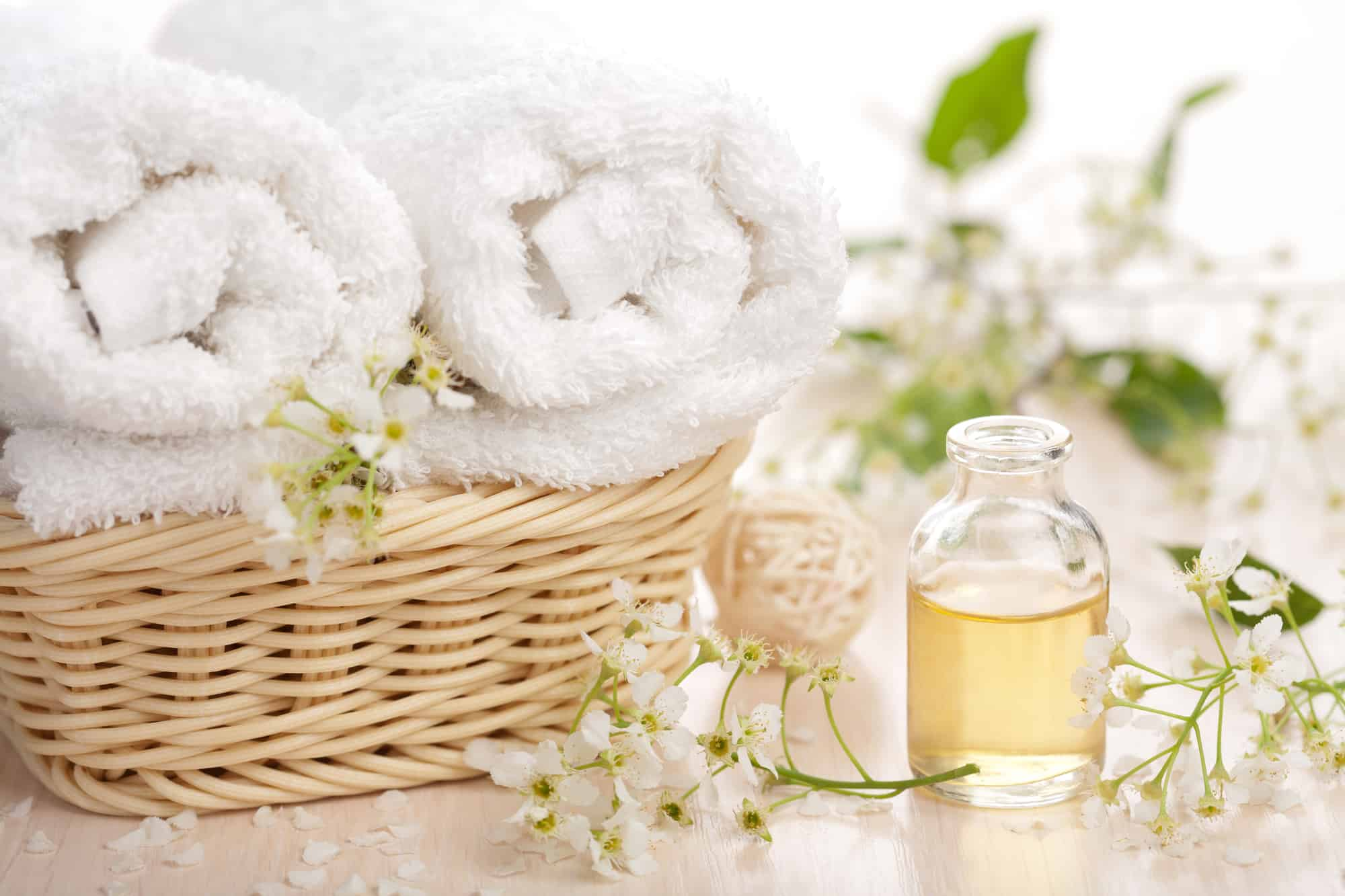 essential oils and towels for the shower