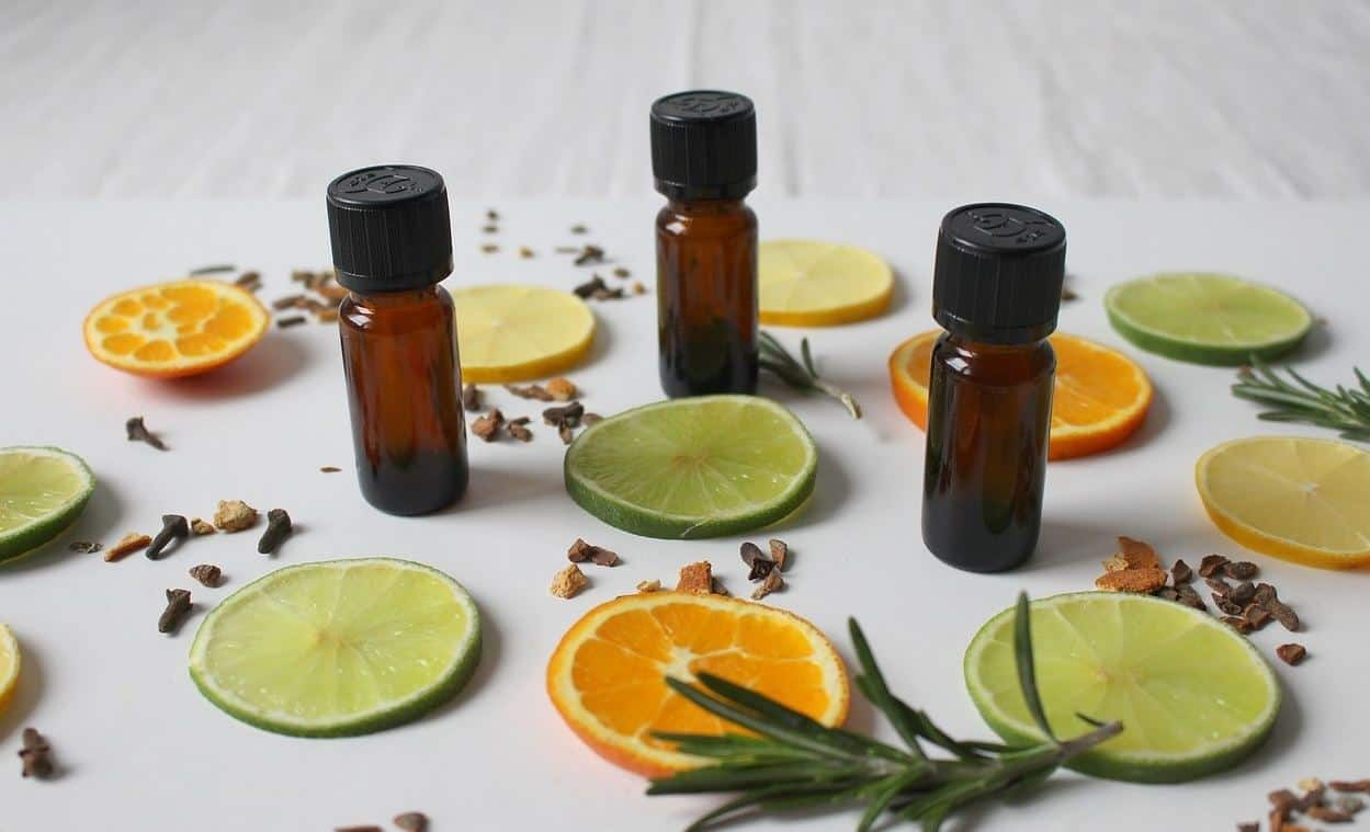 essential oil bottles with citrus slices