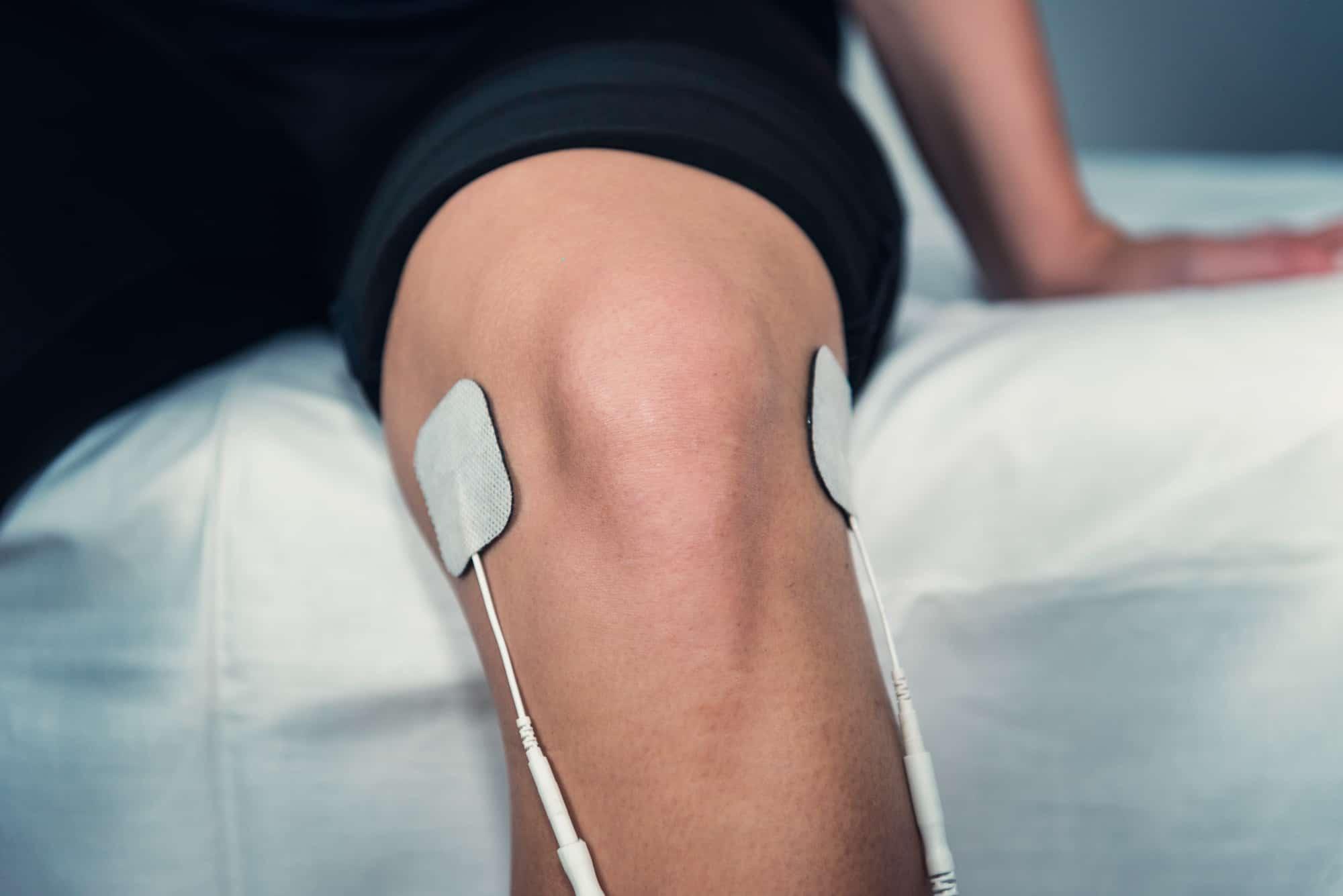 receiving TENS treatment on knee