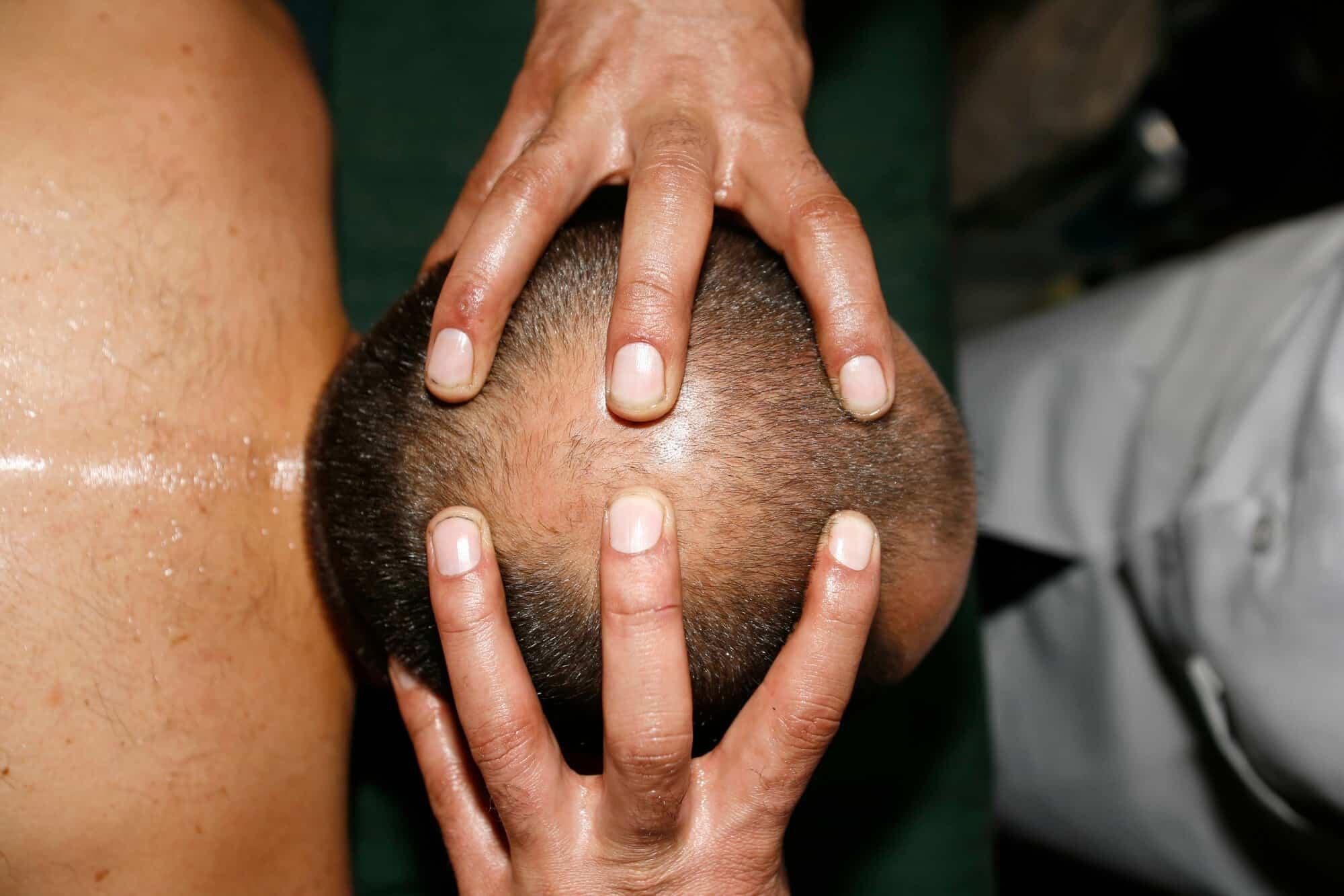 man getting an Indian head massage