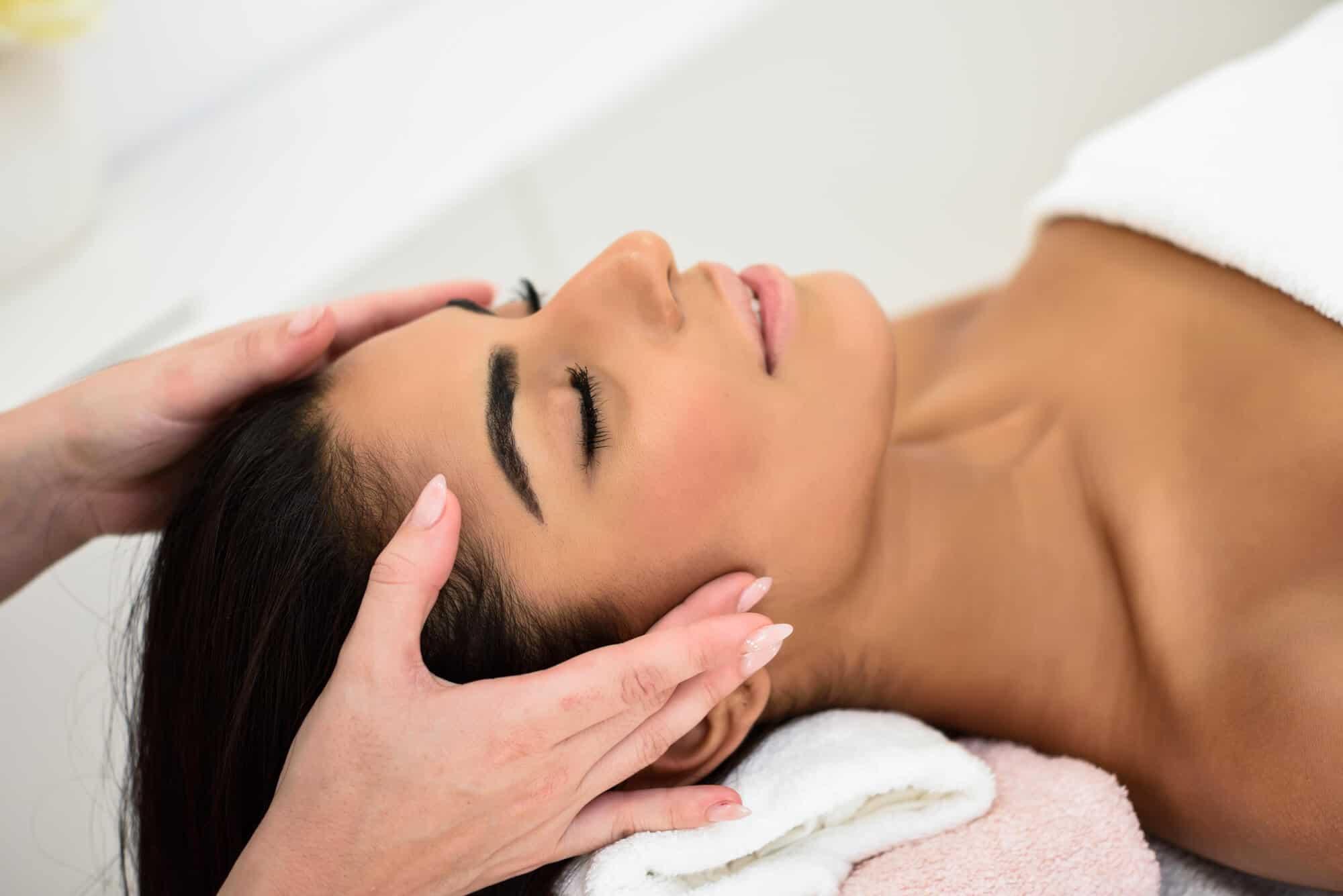 woman getting an Indian head massage