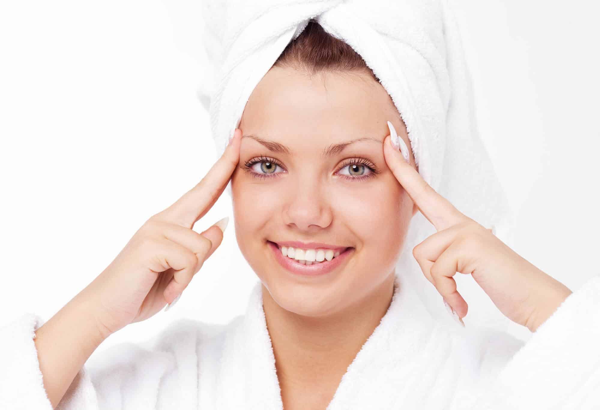 woman giving herself a head self-massage