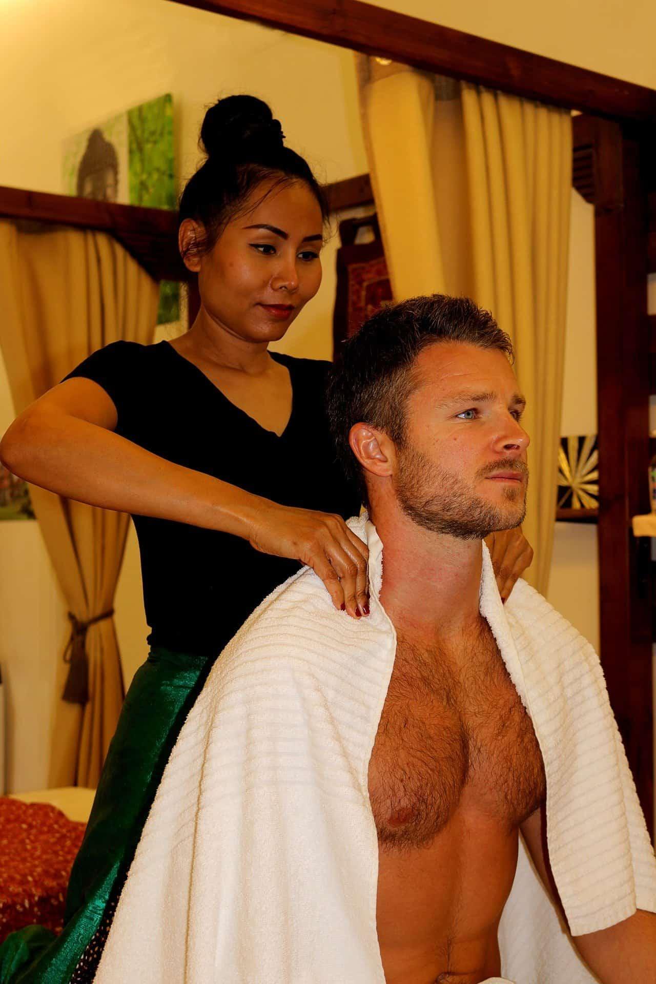 woman giving a man a thai massage